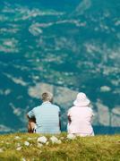 Couple admiring rural hillside view Stock Photos