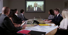 4k, business team sitting in the board room and having a video conference . - stock footage