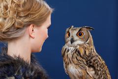 Woman admiring owl - stock photo