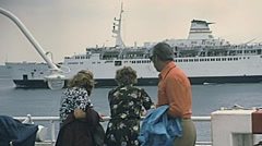 Reggio Calabria 1975: tourists waiting for the ferry to Sicily Stock Footage