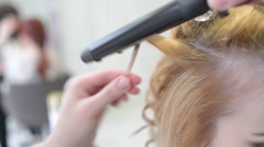 Hairstyle Artist makes Hair Curling Iron Procedure Stock Footage