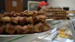 Meat products - kebab and lula kebab on of glass showcase fast-food cafe Stock Footage