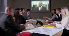 4k, business team sitting in the board room and having a video conference . Stock Footage