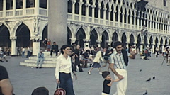 Venice 1975: tourists walking in Saint Mark square Stock Footage