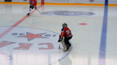 Goalkeeper is warming up before the Ice hockey match - stock footage