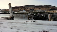 A slider shot of old docks with small boats located in Ferryland, NL. Stock Footage