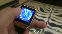 A Man holding and uses  A Smart Watch iwatch  in his hand 4K 2 Stock Footage