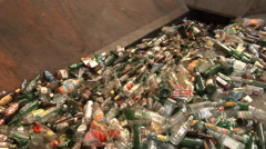 Material Recovery Facility. Waste glass loaded on a conveyor belt. Stock Footage