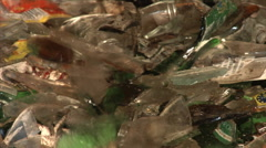 Fractures of waste glass falling into a container - closeup. Stock Footage