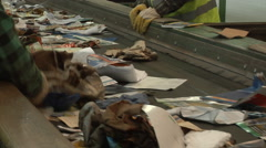 Hand sorting of waste paper in a Mixed Waste Processing Facility. Stock Footage