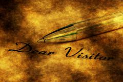 Fountain pen on dear visitor text Stock Illustration