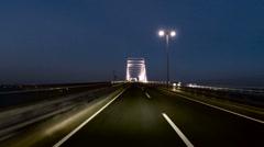 Futuristic drive over a modern illuminated bridge. Stock Footage