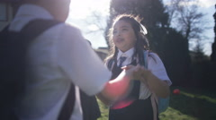 4K Happy young children playing pat a cake outdoors in school playground Stock Footage