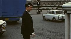 Paris 1975: policeman driving traffic Stock Footage