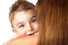 Baby boy playing peek-a-boo Stock Photos