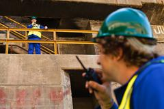 Workers using walkie talkies on dry dock Stock Photos