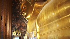Tourist Sleeping Buddha, Reclining Buddha statue in Wat Pho of Bangkok, Thailand Stock Footage