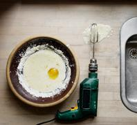 Egg and beater attached to power drill Stock Photos