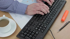 Accountant typing on his computer keyboard - stock footage