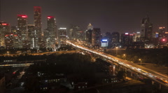 Evening time lapse, night traffic, financial district Beijing, China Stock Footage