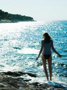 Young woman walking in sea, Dubrovnik, Croatia Stock Photos