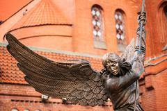 Statue Of Archangel Near Red Church In Minsk, Belarus - stock photo