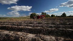 Harvesting potatoes using by a modern potato harvester Stock Footage