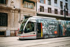 Modern tram Tussam on the line in Seville, Spain Stock Photos