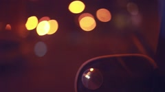 Defocusing background on night road with bokeh and car mirror. 1920x1080 Stock Footage