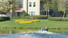 Amphibian Car Convertible Going in Water in Disney Spring Orlando FL Stock Footage