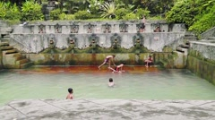 Stock Video Footage of Local children are playing in Hot Spring Air Panas Banjar,Bali.