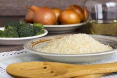 handful of rice grains - stock photo