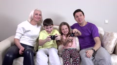 Family playing video games in the living room, slowmotion Stock Footage