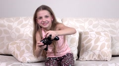 Child playing video game on tv in morning, slowmotion - stock footage