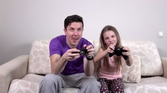 Father and daughter with video game controllers, slowmotion - stock footage