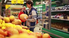 Man chooses a melon for buy in grocery store. 1920x1080 Stock Footage