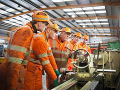 Group of apprentice engineers and engineer training on laithe Stock Photos