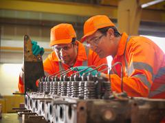 Apprentice engineer and engineer at work Stock Photos