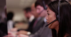 4k, A team of call centre executives wearing headset busy on a phone. - stock footage