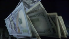 Man throws a stack of hundred dollar bills slow motion Stock Footage