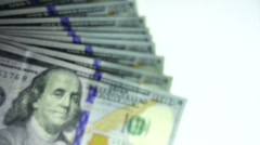 Stack of hundred dollar bills waving at the camera slow motion Stock Footage
