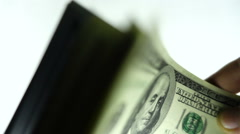 Stack of hundred dollar bills waving to camera close up slow motion Stock Footage