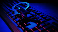 Cyber Crime Handcuffs falls on the keyboard slow motion - stock footage