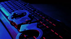 Cyber Crime keboard and handcuffs slow motion - stock footage