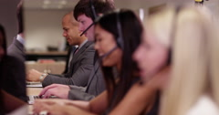 4k, A team of call centre executives wearing headset busy on a phone. Stock Footage