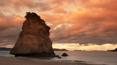 Red sunset at cathedral cove, nz Stock Footage