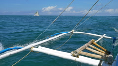 Stabilized shot of traveling by the traditional banca boat in Boracay island. Stock Footage
