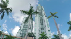 Skyscrapers and modern block of flats buildings in big city - stock footage