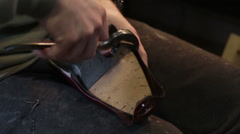Making shoes. Shoemaker sews shoes. - stock footage