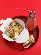 Chicken and vegetables in take out box - stock photo
